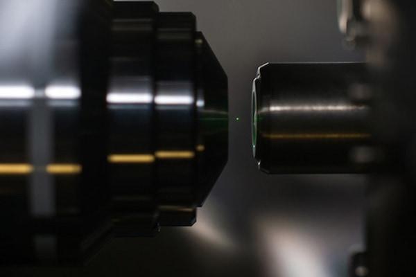 University of Rochester optics professor Nick Vamivakas and physics Ph.D. candidate Levi Neukich perform experiments with optically levitated nanodiam...