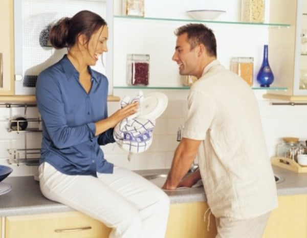 Couple in kitchen, man, woman, dishes, chores, housework, cleaning, domestic, marriage, laugh, clean, msnbc stock photography