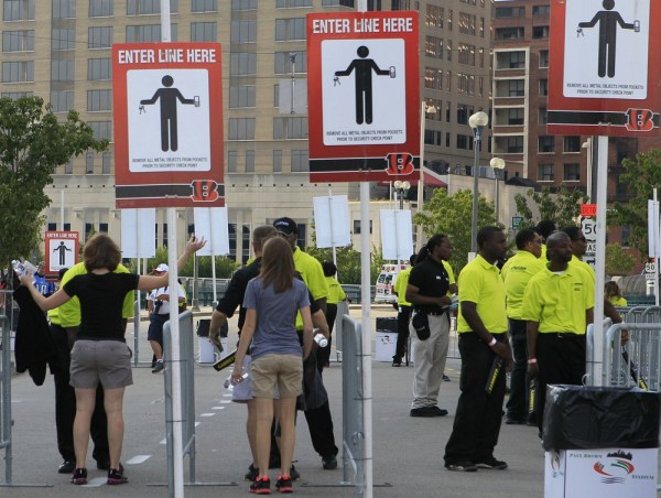 Fans go through security check points prior to an NFL preseason football game between the Cincinnati Bengals and the Tennessee Titans, Saturday, Aug. ...