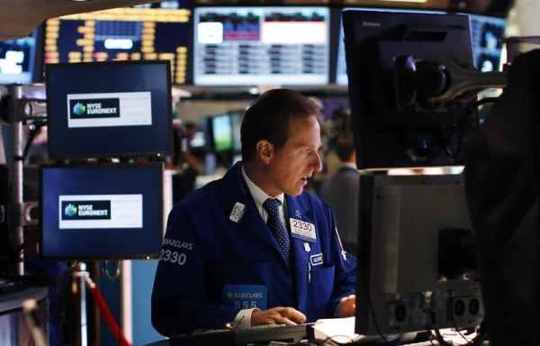 A trader works on the main trading floor of the New York Stock Exchange (NYSE) shortly after the opening bell in New York, May 20, 2013. REUTERS/Mike ...