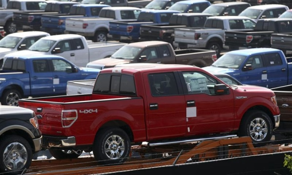 Newly assembled Ford F150 pick-up trucks sit in a holding area before being transported to dealerships outside the Ford Rouge Center in Dearborn, Mich...
