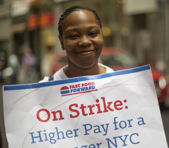 """You're trying to go up and you're just going down,"" said protester Shantel Walker, 31, of Brooklyn who makes $7.25 working at a Papa John's in Manhat..."