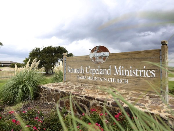 A sign marks the entrance of the Kenneth Copeland Ministries Eagle Mountain Church, Tuesday, Aug. 27, 2013, in Newark, Texas.  The Texas megachurch is...
