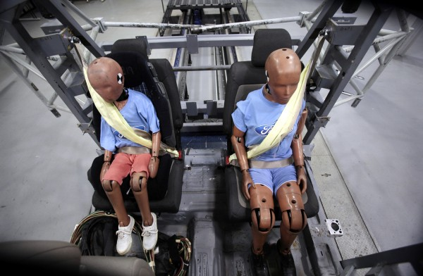 Two Ford Motor Co. crash test dummies sit strapped in a Servo Sled Crash Simulator with seat belt air bags in Dearborn, Michigan November 5, 2009. For...