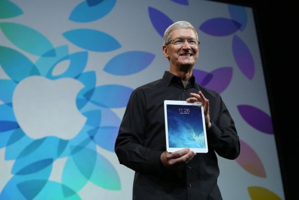 Apple CEO Tim Cook holds up the new iPad Air during an Apple event in San Francisco on Oct. 22, 2013. The company confirmed it has purchased social media analytics startup Topsy.