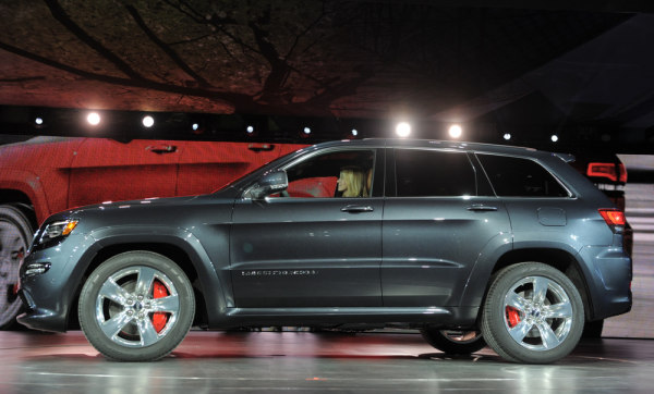 The 2014 Jeep Grand Cherokee SRT high performance version is introduced at the 2013 North American International Auto Show in Detroit, Michigan, Janua...