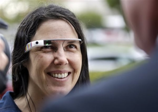 Cecilia Abadie wears her Google Glass as she talks with her attorney outside of traffic court in San Diego.