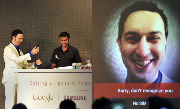"""IMAGE: Matias Duarte, left, senior director of """"Android user experience"""" at Google, tries to demonstrate the """"face unlock"""" feature of the Samsung Galaxy Nexus Android phone"""