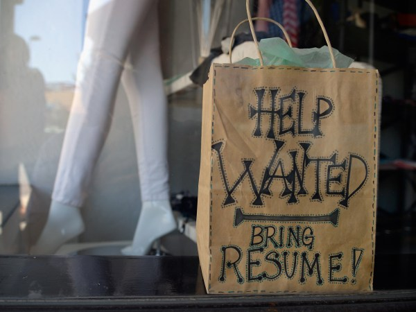 PASADENA, CA - JUNE 21:  A help wanted sign is placed in the window of Veronica M clothing store on June 21, 2013 in Pasadena, California. California ...