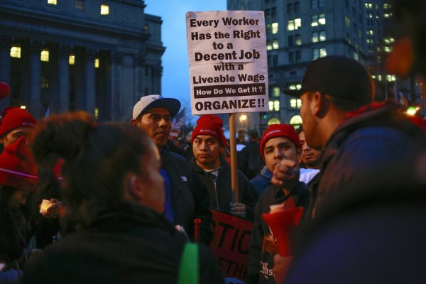 Demonstrators gather during a nationwide strike and protest at fast food restaurants to raise the minimum hourly wage to $15 in New York, December 5, ...
