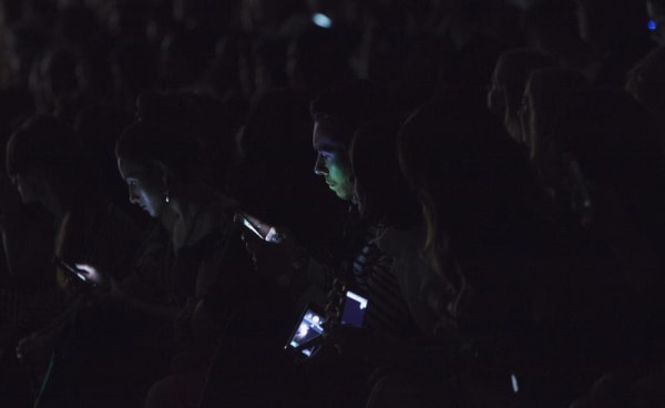 IMAGE: Man checks his cellphone