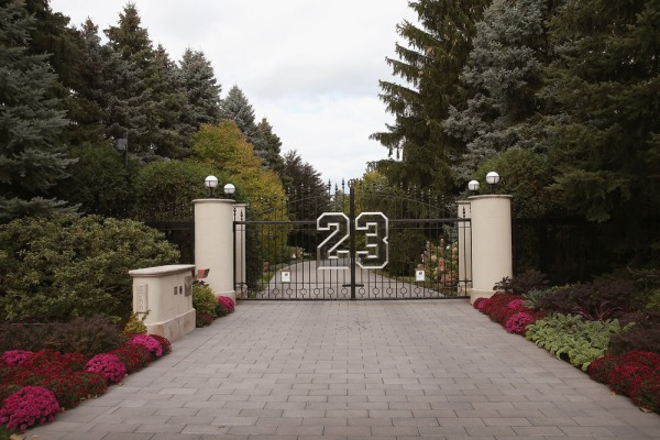 A gate with the number 23 controls access to the home of basketball legend Michael Jordan on October 21, 2013 in Highland Park, Illinois.