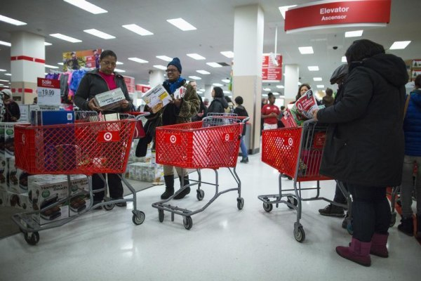 """People shop inside a Target store during Black Friday sales in Brooklyn on Nov. 29. The retailer reportedly had an """"extensive"""" breach of shoppers' credit card information starting that weekend."""