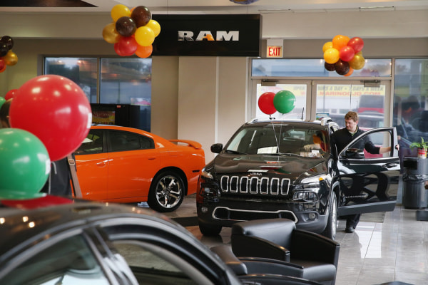 CHICAGO, IL - NOVEMBER 01:  Chrysler Group vehicles are offered for sale at the Marino Chrysler Jeep Dodge dealership on November 1, 2013 in Chicago, ...