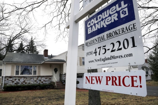 In this Thursday, Dec. 20, 2012, photo, a sign hangs in North Andover, Mass. The Consumer Financial Protection Bureau will force banks to verify a bor...