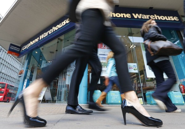 Pedestrians walk past the Carphone Warehouse store on Oxford Street in central London April 30, 2013. U.S. retailer Best Buy Co Inc retreated from its...