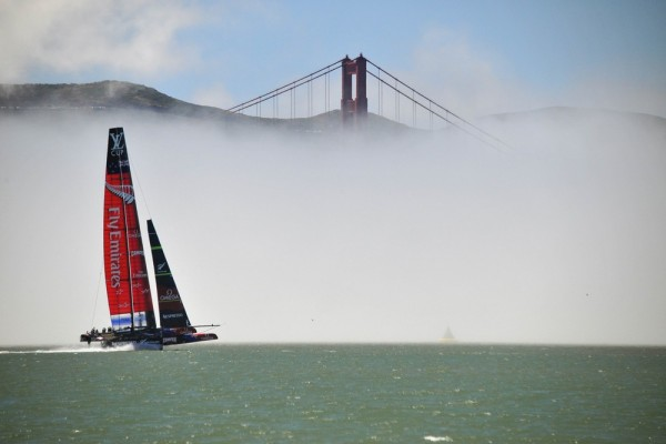 Team Emirates sails their AC-72 Racing Yacht by the Golden Gate Bridge as they test out the course in preparation for the upcoming America's Cup compe...