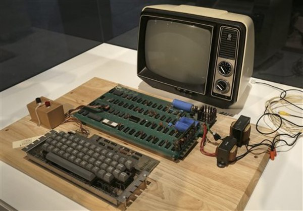 FILE - An Apple 1 computer for sale at auction is seen in a Monday, June 24, 2013 file photo, at the Computer History Museum in Menlo Park, Calif. The...