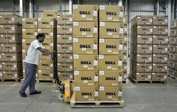 A man pushes a trolley full of Dell computers through a company factory in Sriperumbudur Taluk, in the Kancheepuram district of the southern Indian st...