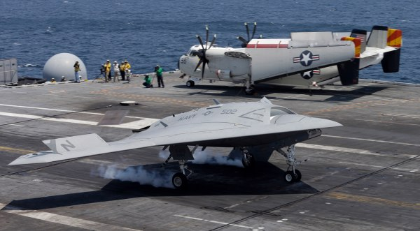 A X47-B Navy drone touches down as it lands aboard the nuclear aircraft carrier USS George H. W. Bush off the Coast of Virginia Wednesday, July 10, 20...