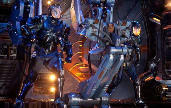 """Raleigh (Charlie Hunnam) and Mako (Rinko Kikuchi) prepare to fight monsters in """"Pacific Rim."""""""