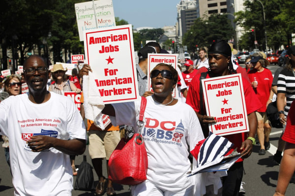 Demonstrators march against amnesty for illegal aliens, during a rally against the immigration reform bill in Pennsylvania Avenue in Washington July 1...