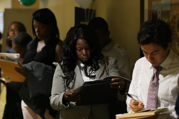 Job seekers wait in line to enter the East Bay's HIREvent on July 17, 2013 in Emeryville, California.