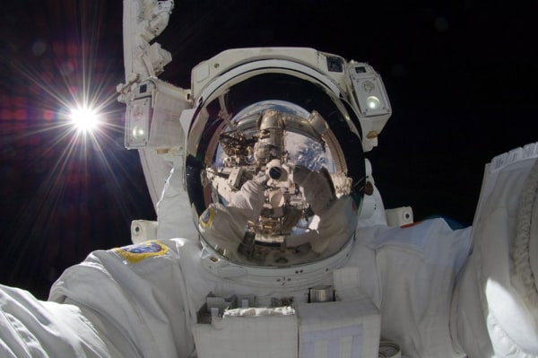 This Sept. 18, 2012 photo released by NASA shows international space station astronaut Aki Hoshide taking a self-portrait while in space. The practice...