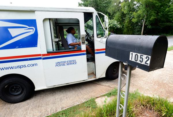 epa03330123 United States Postal Service letter carrier Letonya Lawson makes her deliveries in Avondale Estates, Georgia USA, 31 July 2012. The U.S. P...