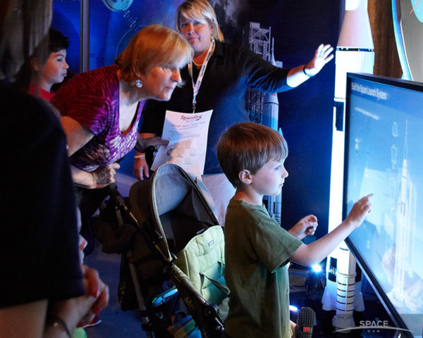 Children explore the interactive exhibits at the Intrepid Museum's SpaceFest.