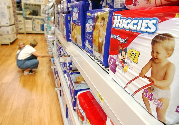 ** FILE ** In a file photo a shopper and her child look at diapers at a Little Rock, Ark., Wal-Mart Super Center store Wednesday, Aug. 24, 2004. Kimbe...
