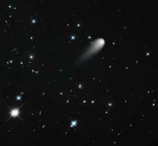 The sun-approaching Comet ISON floats against a seemingly infinite backdrop of numerous galaxies and a handful of foreground stars in this April 2013 ...