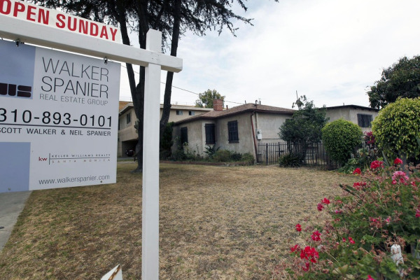 In this Tuesday, June 11, 2013, photo, a single house is offered for sale in Santa Monica, Calif.
