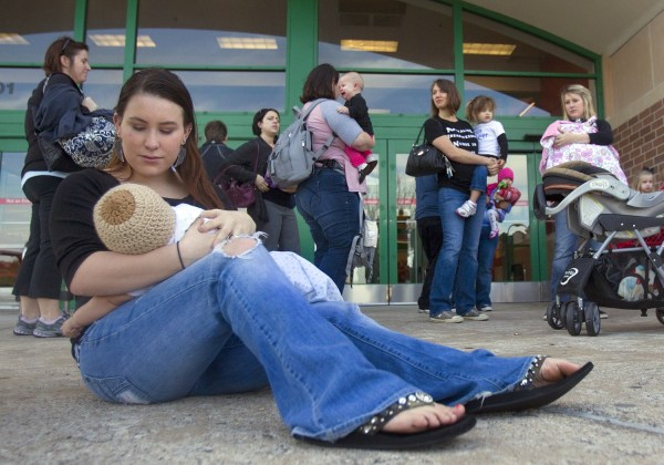 Brittany Hinson breast feeds her 4-month-old son, Kennedy, during a nurse-in in front of a Texas store in 2011,