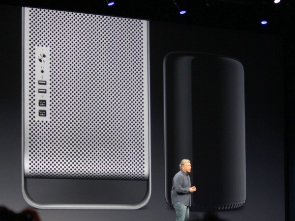 Apple's Phil Schiller demonstrating the size difference between the old Mac Pro (left) and the new one (right), due this fall.