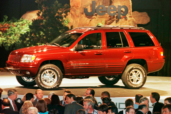 Chrysler introduced the all-new 1999 Jeep Grand Cherokee in Detroit's Cobo Center in Detroit, Michigan in this June 16, 1998, file photo. Chrysler Gro...