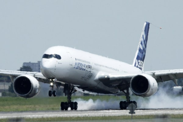 The new Airbus A350 lands at Toulouse-Blagnac airport after its maiden flight in southwestern France last week.