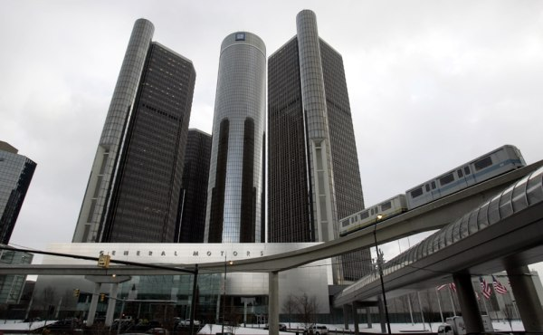** FOR IMMEDIATE RELEASE **Detroit's elevated people mover drives by the Renaissance Center on Dec. 16, 2005.The skyscrapers of the Renaissance Center...