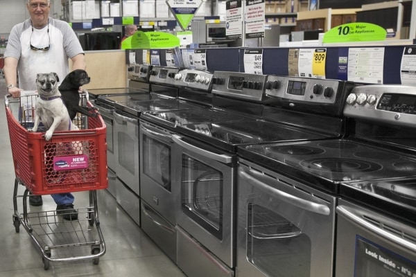 Hmm, maybe we should head over to the gas appliance aisle. Tom Klitzke of Omaha walks his pugs Max, left, and Bear, right, past home appliances at a L...