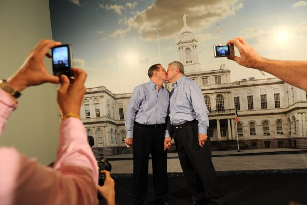 Same-sex couple Ray Durand (L) and his partner Dale Shields kiss while having their picture taken after their wedding ceremony at the Manhattan City Clerk's office on the first day New York State's Marriage Equality Act went into effect July 24, 2011 in New York City.