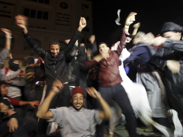 """Activists and demonstrators against Egyptian President Mohamed Mursi perform a new dance craze, the """"Harlem Shake"""", in front of the Muslim Brotherhood..."""