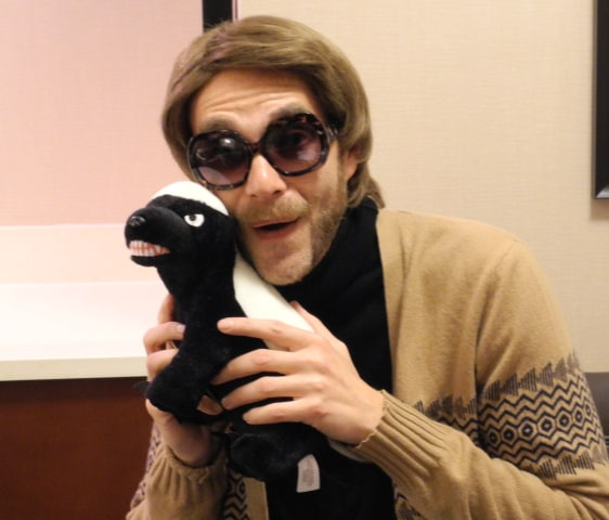 Randall cozies up with the only safe honey badger, a plushie honey badger, at South by Southwest in Austin.