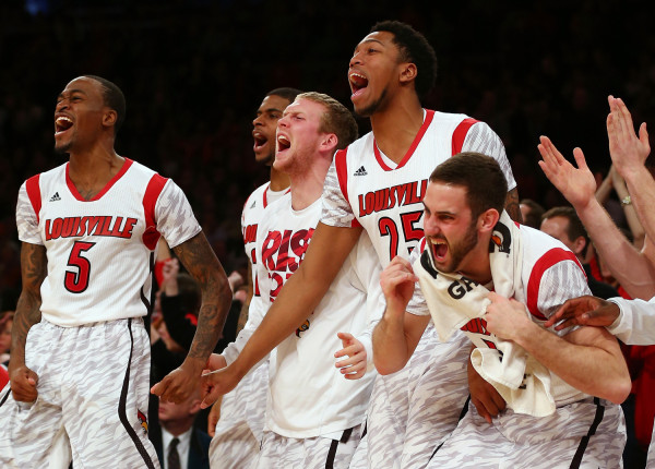 NEW YORK, NY - MARCH 16:  Louisville Cardinals players celebrate on the bench against the Syracuse Orange during the final of the Big East Men's Baske...