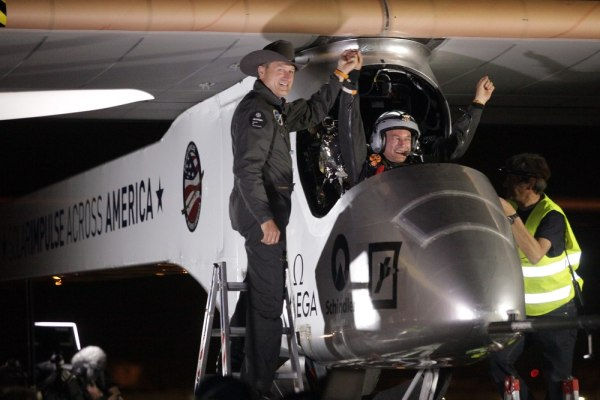 Image: Solar Impulse co-founder, pilot and CEO Andre Borschberg, left, greets pilot Bertrand Piccard at Sky Harbor International Airport in Phoenix
