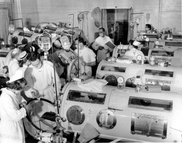 "This is a scene in the emergency polio ward at Haynes Memorial Hospital in Boston, Ma. on Aug. 16, 1955, showing critical victims lined up in ""iron-lung"" respirators."