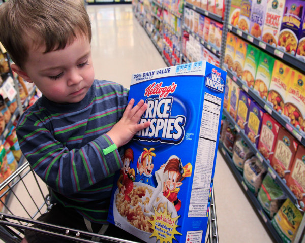 Evan Olmstead, 2, looks at Kellogg's Rice Krispies cereal at Piazza's grocery store in Palo Alto, Calif., Tuesday, May 3, 2011. Kellogg Co.'s first-qu...