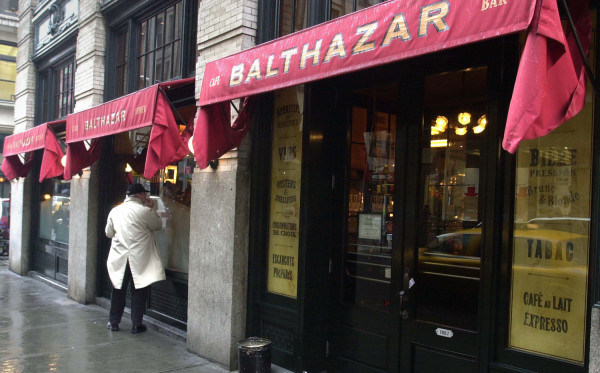NEW YORK - JANUARY 31:  A pedestrian walks past the front of the SoHo restaurant Balthazar Janauary 31, 2003 in New York City. The French style bistro...