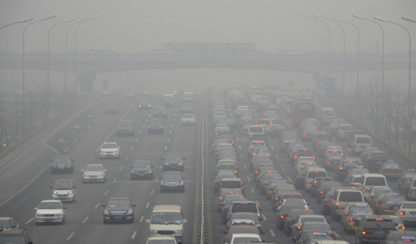 (FILES) -- A file photo taken on January 29,2013 shows cars driving on an eight lane expressway in Beijing. China, the United States and Qatar were ac...