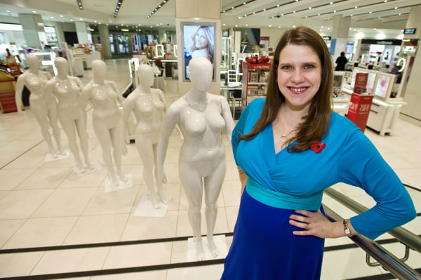 A handout picture from Debenhams shows British Equalities Minister Jo Swinson posing for pictures with size 16 mannequins during a photo call at Deben...