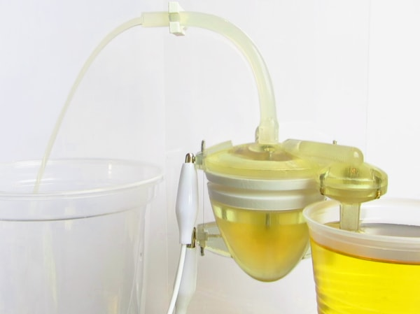 "A mechanical ""heart"" pumps human urine through a microbial fuel cell."